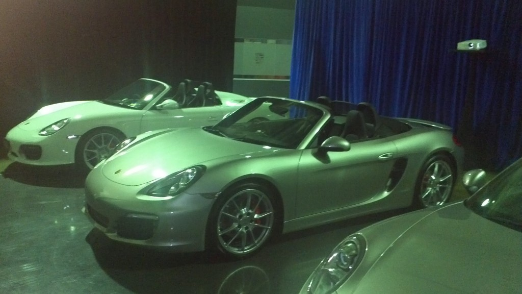 Group of Porsche vehicles on display